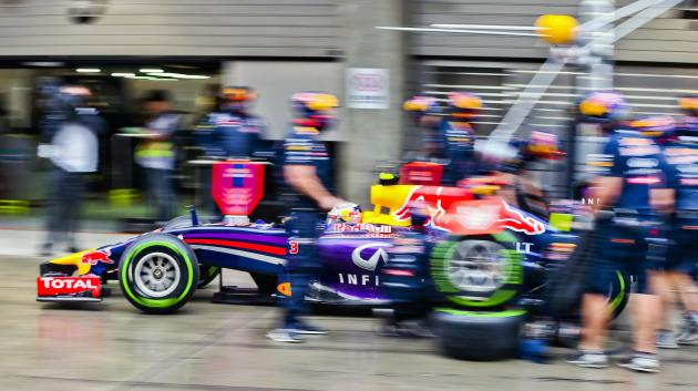 Red Bull Formula One driver Ricciardo of Australia leaves the pits after a stop during the qualifying session for the the Chinese F1 Grand Prix at the Shanghai International circuit