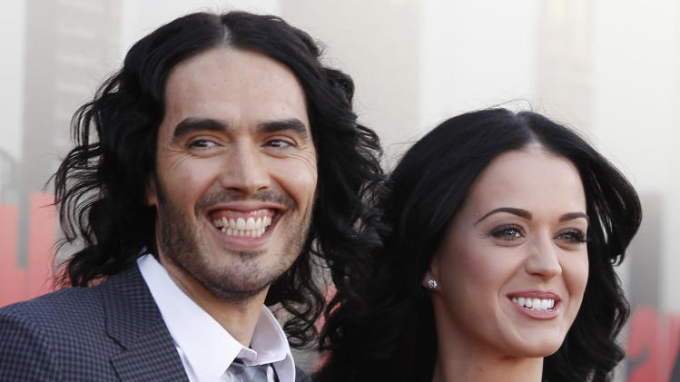FILE-   In this Tuesday, April 19, 2011 file photo, British actor Russell Brand and his wife Katy Perry arrive for the European premiere of Arthur, in London.  (AP Photo/Joel Ryan, FILE
