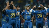 Sri Lankan bowler Lasith Malinga celebrates with teammates after taking the wicket of New Zealand's Martin Guptill in the super over during the Twenty20 Cricket World Cup's Super Eight. Sri Lanka and the West Indies were eyeing semi-final places after hard-fought wins in group one of the Super Eights