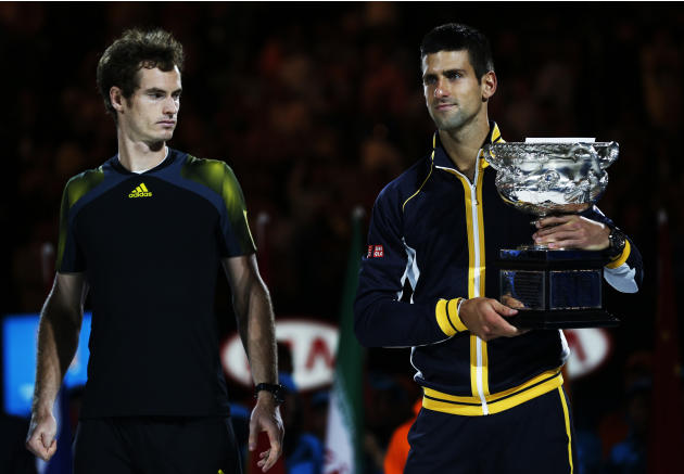 Runner-up Andy Murray of Britain looks on as Novak Djokovic of Serbia poses with the Norman Brookes Challenge Cup after their men's singles final match at the Australian Open tennis tournament in Melb
