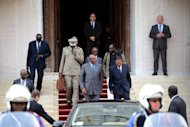 Mali's Prime Minister Cheikh Modibo Diarra (C) leaves after a meeting with France's foreign minister. France would provide logistical support for any military intervention in northern Mali, which was overrun by Islamist militants this year, Defence Minister Jean-Yves Le Drian said Thursday.