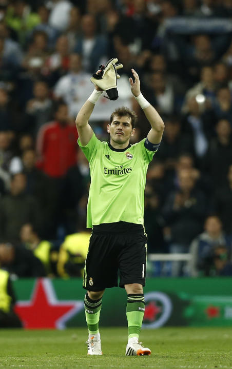 Real goalkeeper Iker Casillas celebrates at the end of a first leg semifinal Champions League soccer match between Real Madrid and Bayern Munich at the Santiago Bernabeu stadium in Madrid, Spain, Wedn