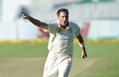 Ryan Harris of Australia celebrates as he takes the last wicket to win Australia on Day 5 of the third Test match between South Africa and Australia a...
