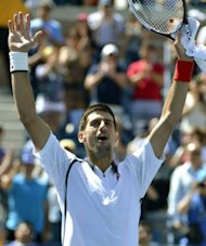 Novak Djokovic of Serbia celebrates after winning against David Ferrer of Spain during their 2012 US Open men's singles semifinals match at the USTA Billie Jean King National Tennis Center in New York