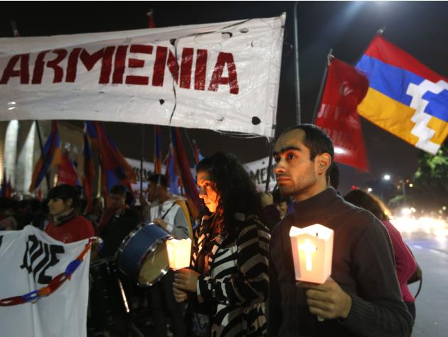 Members of the Armenian community take part in a rally commemorating the 1915 mass killing of Armenians in the Ottoman Empire, in Buenos Aires