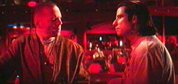 Bruce Willis as Butch and John Travolta as Vincent in Miramax's Pulp Fiction