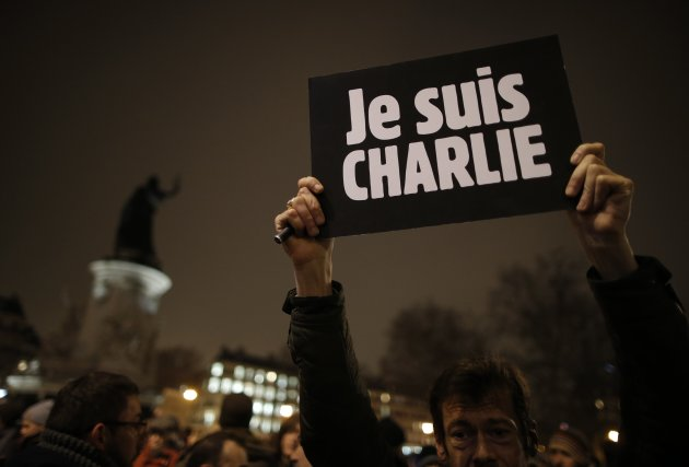 A man holds a placard which reads I am Charlie in Paris Jan. 7, 2015 (REUTERS/Christian Hartmann)
