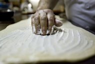 A Spanish baker prepares ensaimadas at a bakery in Palma de Mallorca in 2011. Spain now boasts seven three-star restaurants after two new establishments won the coveted top-notch status in Michelin's 2013 guide released here