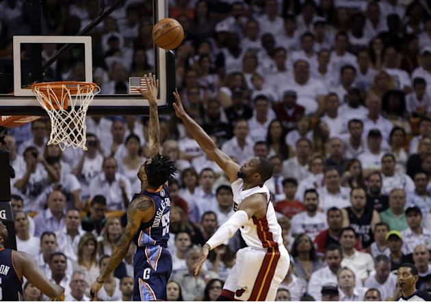 Miami Heat's Dwyane Wade, right, shoots aover Charlotte Bobcats' Chris Douglas-Roberts (55) during the second half in Game 2 of an opening-round NBA basketball playoff series, Wednesday, April