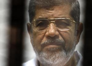 Egyptian ousted Islamist president Mohamed Morsi looks …
