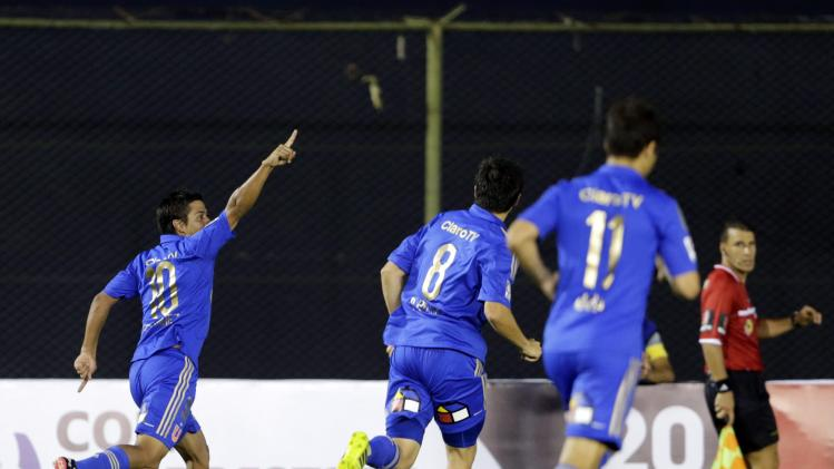 Ramon Ignacio Fernandez of Chile's Universidad de Chile celebrates a goal with teammates Rodrigo Mora and Rodrigo Rojas during their Copa Libertadores soccer match against Paraguay's Guarani in Asuncion