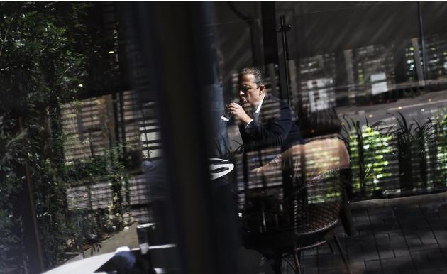PSB presidential candidate Campos is reflected on glass during an interview with Reuters in Sao Paulo