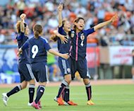 Japan's Homare Sawa (2nd R) celebrates her goal with teammates during their football friendly against Australia in Tokyo on July 11. Japan's world champion women footballers have kicked up a fuss after being left in economy class while their male colleagues lived it up in business on a flight to Europe for the London Olympics