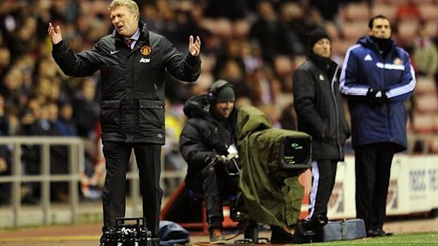 David Moyes, left, admits United 'are going through a difficult time'