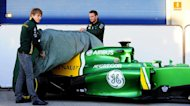 Caterham drivers Giedo van der Garde (right) and Charles Pic unveil the team's new car in Jerez today. The Caterham F1 racing team unveiled their new car for the 2013 season on the first day of pre-season testing in Jerez, alongside the two new drivers