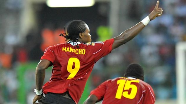 "Angola's Mateus Contreiras Alberto know as ""Manucho"" (L) celebrates next to his teammate Miguel Geraldo Quiami (R) after scoring against Burkina Faso during their Africa Cup of Nations (CAN), group B, football match at the Malabo stadium in Malabo on Janu"