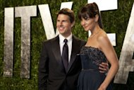"Katie Holmes and Tom Cruise pictured at the Vanity Fair Oscar Party in February. The Church of Scientology denounced as ""hogwash"" a report that it auditioned candidates to be Tom Cruise's girlfriend in 2004, after his split from Nicole Kidman and before he met and married Katie Holmes"