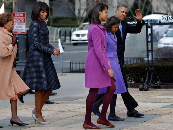 "This is the second time Obama has worn Thom Browne, having worn a dress by the label for the third presidential debate in 2012. According to the New York Times, ""Thom Browne's coat and dress for Michelle Obama are both made of silk jacquard based on a necktie fabric, custom made for the First Lady."" (AP Photo/Jacquelyn Martin)"