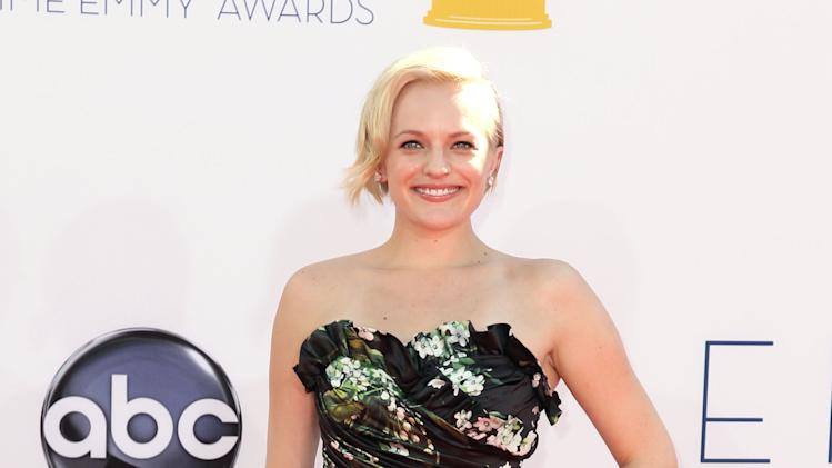 Elisabeth Moss arrives at the 64th Primetime Emmy Awards at the Nokia Theatre on Sunday, Sept. 23, 2012, in Los Angeles. (Photo by Matt Sayles/Invision/AP)