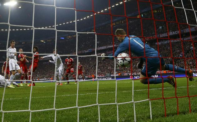 Bayern Munich's goalkeeper Manuel Neuer tries to stop Sergio Ramos' first goal during their Champions League semi-final second leg soccer match in Munich