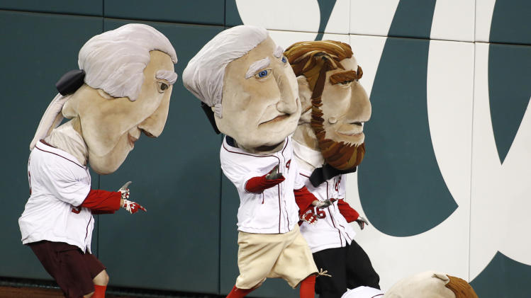 Theodore Roosevelt mascot falls to the ground during the Presidents Race in Game 5 of the MLB NLDS baseball series between the St. Louis Cardinals and the Washington Nationsl in Washington