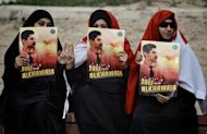 Bahrain demonstrators call for the release of jailed activist Abdulhadi al-Khawaja in Bahrain in April. Khawaja, facing a life sentence on charges of seeking to overthrow Bahrain's Sunni rulers, will on Monday end a hunger strike that lasted 110 days, his lawyer said