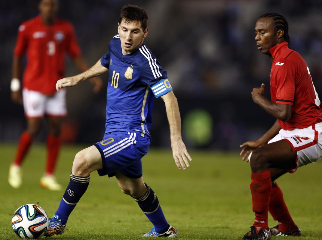Argentina's Messi controls the ball in front of Trinindad and Tobago's Marshall during their friendly soccer match in Buenos Aires
