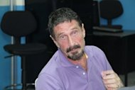 Guatemala has refused to grant asylum to US anti-virus software pioneer John McAfee, pictured December 5, who is wanted for questioning over the murder of his neighbour in Belize. McAfee's neighbor, Florida expat Gregory Faull, was discovered on November 11 by his housekeeper with a 9-mm slug in his head, lying in a pool of his own blood.