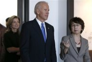 U.S. Vice President Joe Biden (C) and U.S. Ambassador to Japan Caroline Kennedy (L) inspect the headquarters of internet commerce and mobile games provider DeNA Co with the company's founder Tomoko Namba in Tokyo December 3, 2013. REUTERS/Toru Hanai