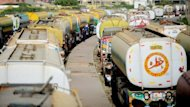 Tankers transporting fuel to NATO forces in Afghanistan, are parked near oil terminals in Pakistan's port city of Karachi. A Taliban bomb attack destroyed 22 fuel tankers carrying supplies for NATO forces in Afghanistan, local officials said, as 12 Afghan soldiers and two NATO troops died in escalating insurgent attacks