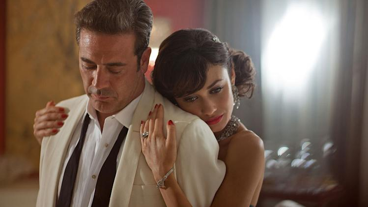 "Jeffrey Dean Morgan as Ike Evans and Olga Kurylenko as Vera Evans in ""Magic City."""