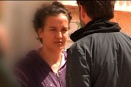 "This photo, obtained on April 6, 2013 from Capa TV, shows a screen grab from undated footage broadcast by the television show ""L'effet Papillon"" on the French station Canal+ of Amina Tyler (L) speaking to a French journalist at an undisclosed location in Tunisia. These are the first images of the young Tunisian woman since she caused a scandal by publishing photographs of her bare chest online."