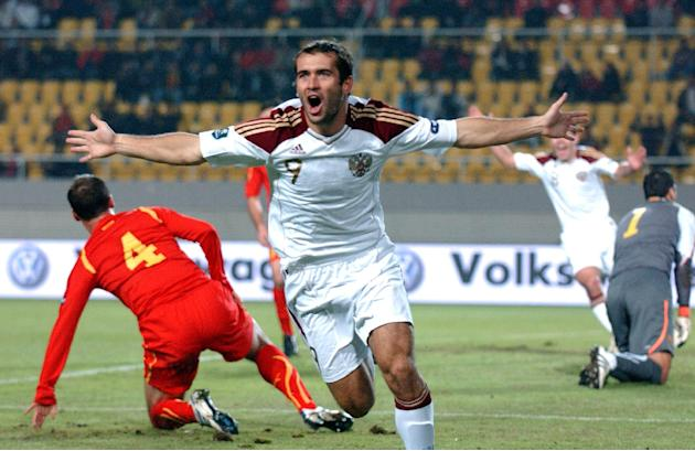 In this Oct. 12, 2010, file photo, Russia's Alexander Kerzhakov, center, celebrates after scoring against Macedonia, during their Euro 2012 Group B qualifying soccer match in Skopje, Macedonia