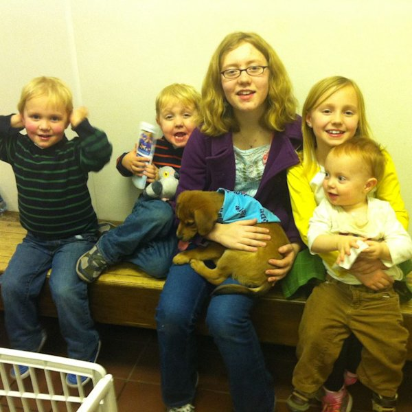 The Cordell children showing off their new puppy. (Facebook)