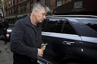 Actor Alec Baldwin steps out of his SUV outside his apartment in New York November 15, 2013. REUTERS/Carlo Allegri