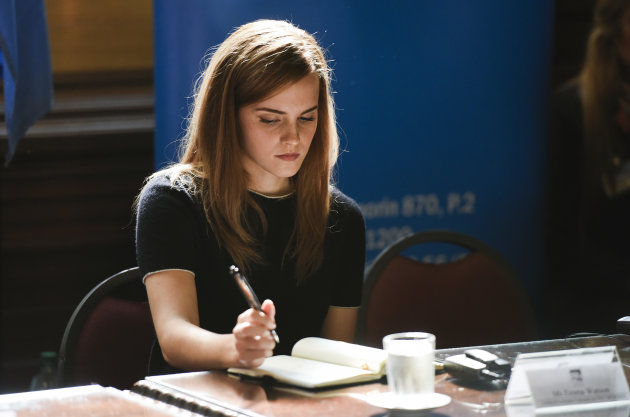 Emma Watson takes notes during an event at Parliament in Montevideo, Uruguay. (9/17/14) (AP Photo/Matilde Campodonico)