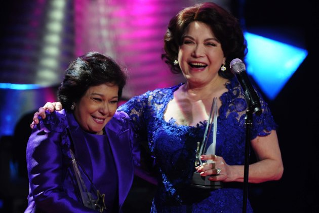 "Nora Aunor and Helen Gamboa laugh on stage as they receive their awards""Best Drama Actress"" during the 26th Star Awards for TV held at the Henry Lee Irwin Theater in Ateneo De Manila University on 18 November 2012. (Angela Galia/NPPA images)"