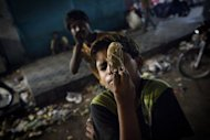 A Pakistani street child sex worker is seen sniffing glue in Karachi. According to charities which work to protect street children in Pakistan, up to 90 percent are sexually abused on the first night that they sleep rough and 60 percent accuse police of sexually abusing them