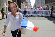 "A person wears a mask representing French president François Hollande during a demonstration called by the anti-gay marriage movement ""La Manif Pour Tous"" (Demonstration for all !) on May 5, 2013 in Lyon, central eastern France"