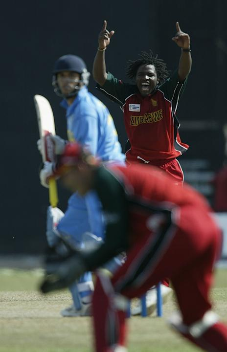 Douglas Hondo of Zimbabwe celebrates dismissing Yousuf Youhana of India
