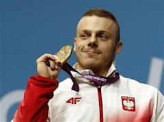 Poland's Adrian Edward Zielinski poses with his gold medal on the podium of the men's 85Kg weightlifting competition at the ExCel venue at the London ...