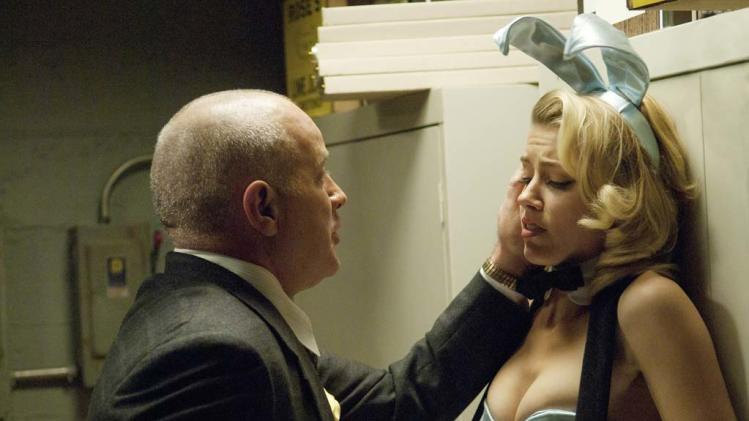 "Randy Steinmeyer as Clyde Hill and Amber Heard as Maureen in ""The Playboy Club."""