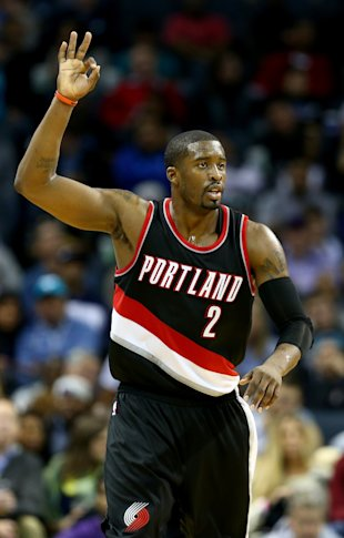 CHARLOTTE, NC - NOVEMBER 26:  Wesley Matthews #2 of the Portland Trail Blazers reacts after making a shot against the Charlotte Hornets during their game at Time Warner Cable Arena on November 26, 2014 in Charlotte, North Carolina.  NOTE TO USER: User expressly acknowledges and agrees that, by downloading and or using this photograph, User is consenting to the terms and conditions of the Getty Images License Agreement.  (Photo by Streeter Lecka/Getty Images)