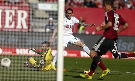 Leverkusen's Hilbert scores during their German first division Bundesliga soccer match in Nuremberg