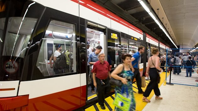 TTC riders exit a subway train in Toronto. (CBC)