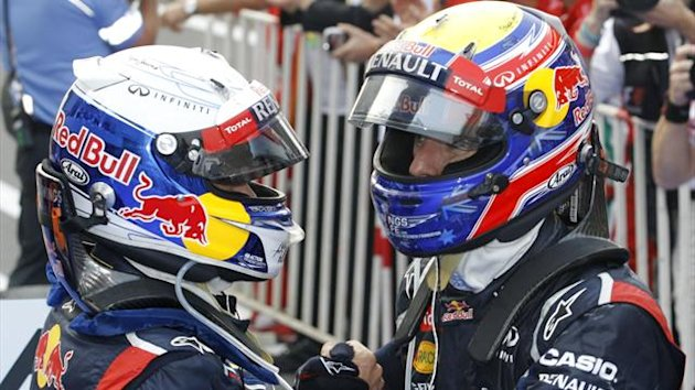 Second placed Red Bull Formula One driver Mark Webber (R) of Australia congratulates team mate Sebastian Vettel (Reuters)