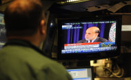 Fed Chairman Ben Bernanke is seen on television on the floor of the New York Stock Exchange holding a news conference after the announcement that the Federal Open Market Committee would leave interest rates unchanged, Wednesday, April 27, 2011, in New York.