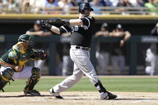 Chicago White Sox designated hitter Andy Wilkins swings against the Oakland Athletics during a spring training baseball game Sunday, March 8, 2015, in Mesa, Ariz. (AP Photo/Ben Margot)