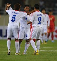 File picture. Myanmar's Aung Kyaw Moe, centre, celebrates with his teammates after scoring a goal at the AFF Suzuki Cup group B match against Vietnam in Hanoi in 2010. Myanmar finished runners-up at the 1968 Asian Cup and qualified for the Munich Olympics in 1972, where they won the Fair Play Award, but their fortunes have been on the dive since