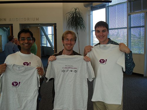 Showing off our shiny new Yahoo OpenID t-shirts